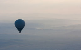 Hot air balloons rise over valley, Turkey Stock Photography