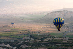 Hot air balloons rise over valley, Turkey Royalty Free Stock Photo