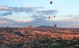 Hot air balloons rise over valley, Turkey Stock Image