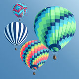Hot air balloons set. Set of  colorful hot air balloons on a blue background view from below Stock Photos