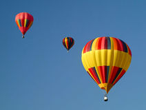 Hot air balloons in the sky. Displaying their brilliant colors Stock Image