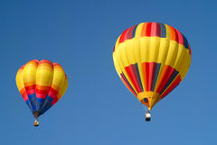 Hot air balloons in the sky. Displaying their brilliant colors Stock Photography