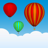 Hot air balloons in the sky. Background with clouds. Colored picture. Vector Royalty Free Stock Photo