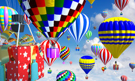 Hot-air balloons in the sky, with basket/gifts. Hot-air balloons in the sky, with gifts in place of the basket Royalty Free Stock Images