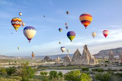 Hot air balloons in the sky over the cave town, Valley of Daggers, Cappadocia, Turkey stock images