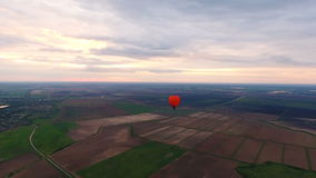 Hot air balloons in the sky over a field.Aerial view stock video footage