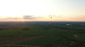 Hot air balloons in the sky over a field.Aerial view stock video