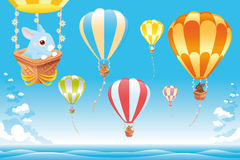 Hot air balloons in the sky on the sea with bunny. Cartoon and scene
