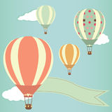 Hot air balloons. In the sky. Vector illustration. Greeting card background Stock Image