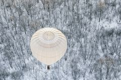Hot air balloons in the sky. In winter royalty free stock photo
