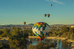 Hot Air Balloons soar over Lake Havasu Arizona Royalty Free Stock Photo