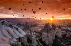 Hot air balloons at sunrise in Cappadocia, Turkey. Hot air balloons take off to catch the sunrise in Cappadocia, Turkey Stock Photos