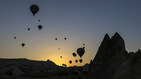 Hot air balloons at sunrise. Hot air balloons floating over Cappadocia, Turkey at sunrise royalty free stock image