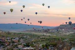 Hot air balloons at sunrise flying over Cappadocia, Goreme, Turkey stock photography