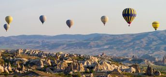 Hot air balloons at sunrise flying over Cappadocia, Turkey stock photo