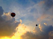 Hot air balloons at sunset Stock Images