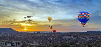Hot air balloons sunset discovery Cappadocia, Anatolia, Turkey. Open air museum, Goreme national park Royalty Free Stock Images