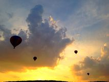 Hot air balloons at sunset. Hot air balloons going over mountain at sunset Stock Photo