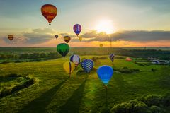 Hot air balloons at sunset. Many hot air balloons at sunset sky background stock photography