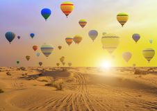Hot air balloons sunset sand desert. View UAE stock images