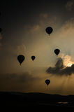Hot air balloons take off  in the evening sky Stock Image