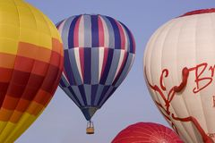 Hot air balloons on takeoff. Here is a photo of several hot air balloons taking off for an enjoyable ride in the sky Stock Images