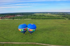 Hot air balloons. Two hot air balloons take off from the field. top view Royalty Free Stock Photography