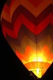 Hot-air baloon. Bright on at night Stock Image
