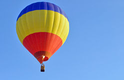 Hot air baloon. Is flying in a sky Royalty Free Stock Photography