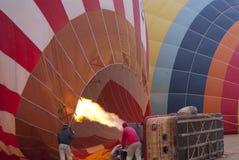 Hot air baloon blowing. People blowing up hot air baloon Royalty Free Stock Image