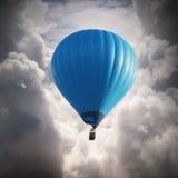 Hot air baloon. Blue hot air baloon on the sky royalty free stock photo