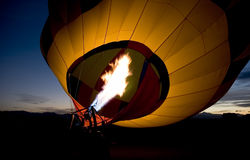 Hot air baloon burner. With mountains in background stock photo