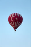 Hot Air Baloon over Cappadocia at sunrise. Royalty Free Stock Image