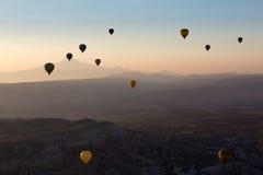 Hot Air Baloon over Cappadocia at sunrise. Stock Photo