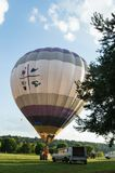 Hot air baloon prepare to fly. Hot air baloon on land preparing to fly Royalty Free Stock Photos