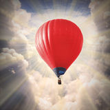 Hot air baloon. Red hot air baloon on the sky royalty free stock photos