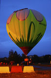 Hot air baloon starting to fly in the evening sky Stock Image