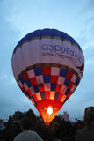Hot air baloon starting to fly in the evening sky. A Hot air baloon starting to fly in the evening sky Royalty Free Stock Photo