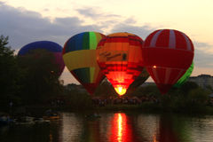 Hot air baloon starting to fly in the evening sky. A Hot air baloon starting to fly in the evening sky Stock Image