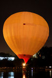 Hot air baloon starting to fly in the evening sky Royalty Free Stock Photography