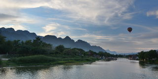 Hot air balooning at sunset. Vang Vieng. Laos. Vang Vieng is a tourist-oriented town in Laos in Vientiane Province about four hours bus ride north of the capital Royalty Free Stock Images