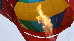 Hot air burning to the air balloon during the flight stock footage