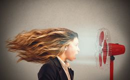 Hot air. The air fan moves the woman hair Stock Image