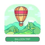 Hot air flying balloon. Travel and trip. Stripped and hot air balloon flying over mountain and woods. Airship transport over forest. Outdoor travel and tourism Royalty Free Stock Image