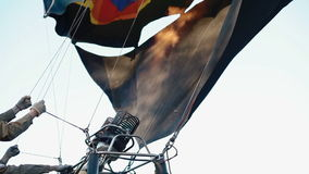Hot air powering air balloon stock footage