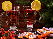 Hot alcohol wine and Christmas cookie with canella stick Stock Photo