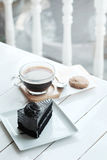 Hot americano black coffee and A piece of charcoal cake on white wooden table. Have some space foe write wording Royalty Free Stock Photos