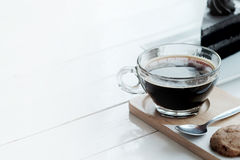 Hot americano black coffee and A piece of charcoal cake on white wooden table. Have some space foe write wording royalty free stock photography