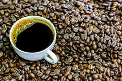 Hot americano, Black coffee in white cup with coffee beans. Royalty Free Stock Image