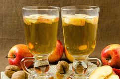 Hot apple cider with apples and slices in cups Royalty Free Stock Photography